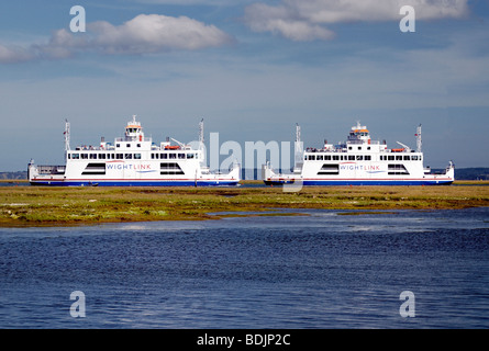 Two car passenger ferries passing each other between Lymington and The Isle of Wight - Stock Photo