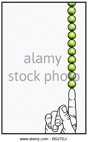 Stack of peas balanced on pointing finger - Stock Photo