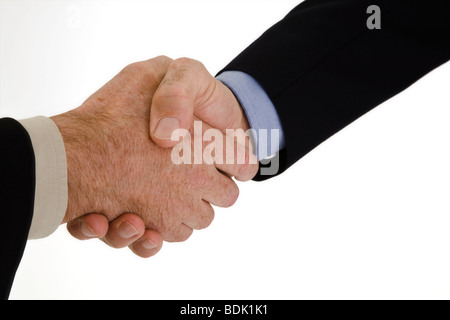 A Caucasian businessman in a black business suit and white shirt. He is shown on a white background shaking hands. - Stock Photo