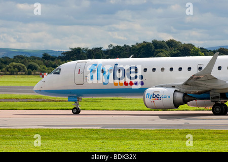 Flybe Embraer 195 on a taxiway at Manchester Airport - Stock Photo