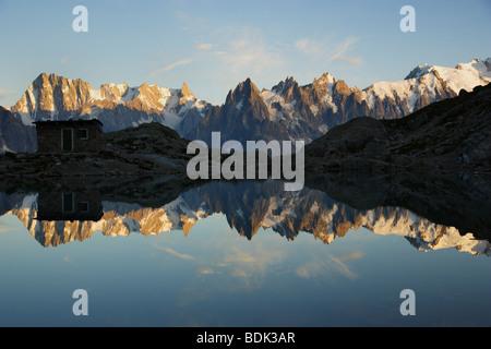 Aiguilles de Chamonix reflecting in Lac Blanc - Stock Photo