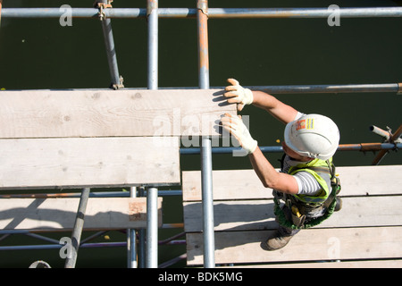 building scaffold scaffolding site construction rig workers - Stock Photo