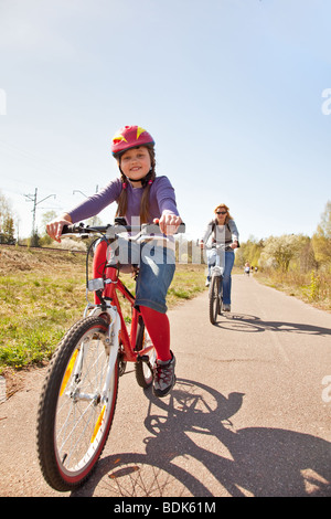 Family on bicycles - Stock Photo