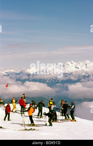 Group of Skiers downhill skiing on Blackcomb Mountain at Whistler Ski Resort in the 'Coast Mountains' of British - Stock Photo