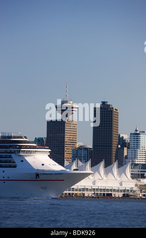 The Carnival Spirit cruise ship leaving downtown Vancouver from Coal Harbour, British Columbia, Canada. - Stock Photo