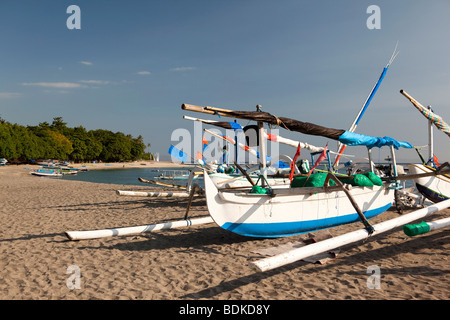 Indonesia, Lombok, Sengiggi, colourful outrigger fishing boats on the beach - Stock Photo