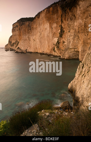 Sea cliffs at Erimitis at dusk on the west of Paxos Island, Ionian Sea, Greece - Stock Photo