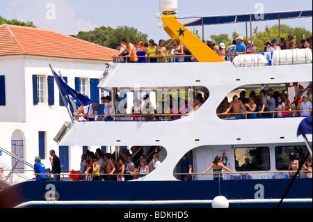 Passenger ferry disembarking in harbour at Fiskardo on the Greek Mediterranean island of Kefalonia Greece GR - Stock Photo