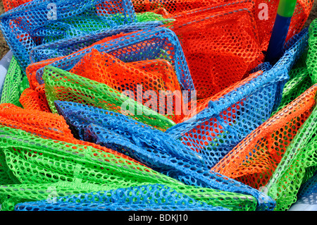 Close up concept shot of colorful childrens plastic fishing nets
