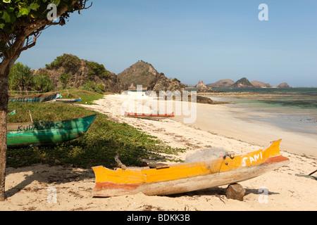 Indonesia, Lombok, South Coast, Kuta, colourfully painted fishing boats on the beach - Stock Photo