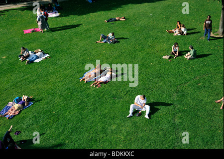 Paris, France - French Adults Relaxing in Grass in Reuilly Park, (near 'Promenade Plantée') Park, Overview, Looking - Stock Photo
