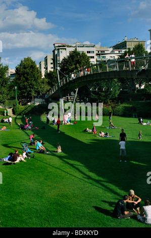 Paris, France - French Adults Relaxing in Grass in Reuilly Park, near 'Promenade Plantée' Park, Overview, Looking - Stock Photo