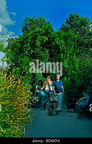 Paris, France - French Families Walking in the 'Promenade Plantée' Public Park, Pathway, Urban Garden Landscaped - Stock Photo