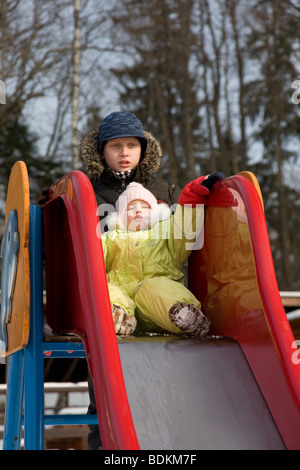 Three Year Old Girl Sliding Down - Stock Photo