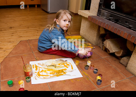 Three Year Old Girl Painting - Stock Photo