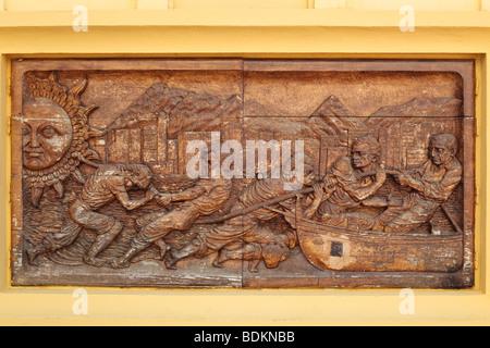 Marbella, Costa del Sol, Malaga Province, Spain. Bas relief carving in wood in Plaza de los Olivos of fishermen - Stock Photo