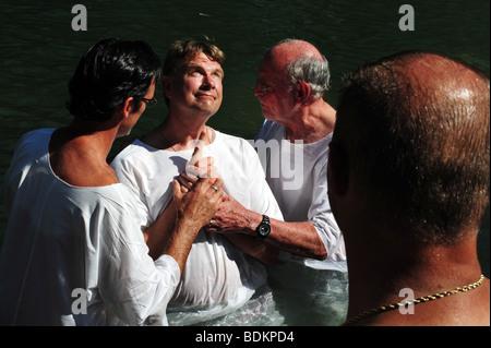 Yardenit Baptismal Site at Jordan river shore. Baptism of Christian pilgrims in Yardenit, Israel - Stock Photo