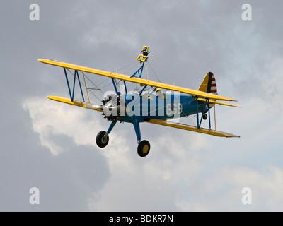 A Boeing Stearman Biplane in flight over Dover. - Stock Photo