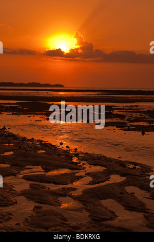 Indonesia, Lombok, Gili Air, north coast, sunset over Gili Trewangan at low tide - Stock Photo