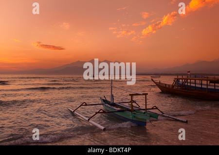 Indonesia, Lombok, Gili Air, East coast, sky over Gunung Rinjani at sunrise - Stock Photo