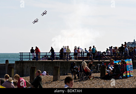 Two biplanes perform for the beach crowds at the Eastbourne airshow, England. - Stock Photo