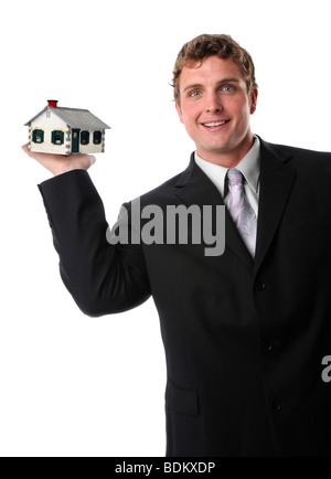 Man holding a small home in hand isolated over a white background - Stock Photo