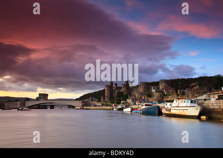 Early morning sunrise over Conwy castle in North Wales. - Stock Photo