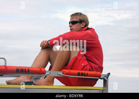 Lifeguard watching beach from top of pick up truck, Whitby, North Yorkshire - Stock Photo