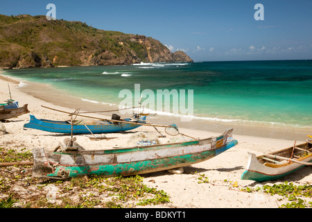 Indonesia, Lombok, South Coast, Mawun, colourfully painted fishing boats on the beach - Stock Photo