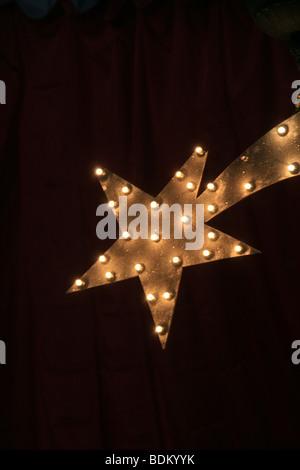 one single illuminated christmas star at night - Stock Photo