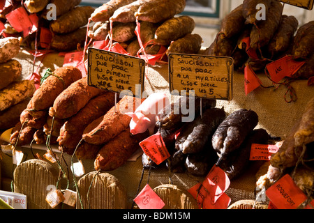 Bratwurst sausages on a Market Stall in St Remy, Provence, France - Stock Photo