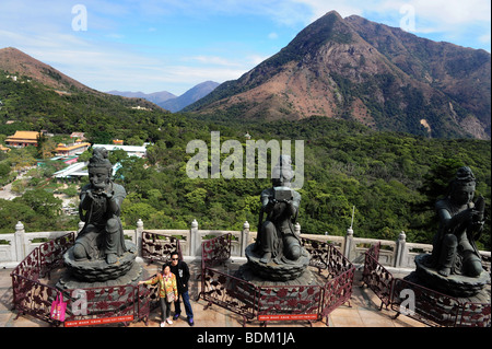 The Offering of the Six Devas: Buddhistic statues praising and making offerings to the Tian Tan Buddha. Po Lin Monastery - Stock Photo