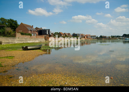 Emsworth quay fronted with houses along the western parade seen from the tide mill at low tide on a sunny day with - Stock Photo