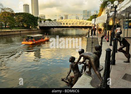 Singapore River towards Marina Bay with Bronze statues of Jumping Children, Boat Quay SIN - Stock Photo