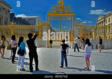 Versailles Palace - Asian Family Tourists Visiting French Monument, Chateau de Versailles, Man Taking Photos in - Stock Photo