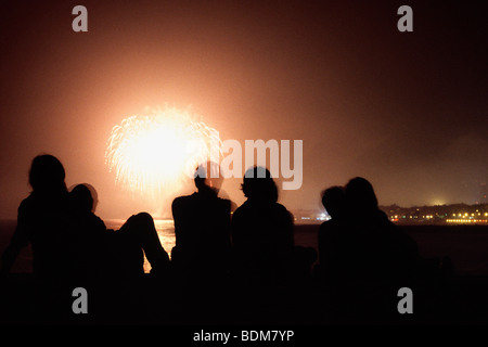 Family watching fireworks in Barcelona