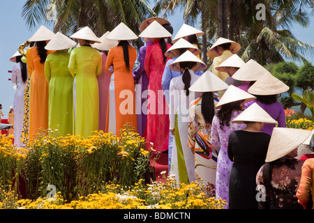 Beautiful Vietnamese woman parade in there traditional dress - Stock Photo