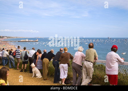 A crowd of people on the cliff top looking out over Bournemouth seafront and pier. Dorset.  Overlooking the beach - Stock Photo