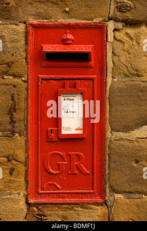 Old red post box set into the wall North Yorkshire England UK United Kingdom GB Great Britain - Stock Photo
