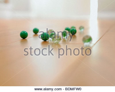 Close up of marbles on the floor - Stock Photo