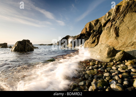 Stunning view of waves crashing against the rocks on the shore line at Penrhyn Llyn beach, Wales - Stock Photo