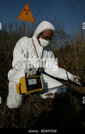 On the ground action training for Greenpeace Radiation Safety Advisors. Measuring radiation levels. - Stock Photo