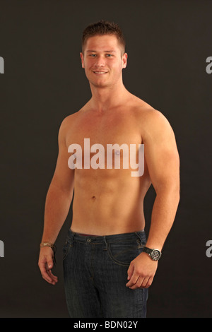 20 year old man without shirt. - Stock Photo