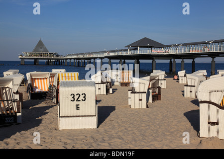 pier of Heringsdorf and wicker beach chairs on the Island of Usedom, Western Pomerania, Germany. Photo by Willy - Stock Photo