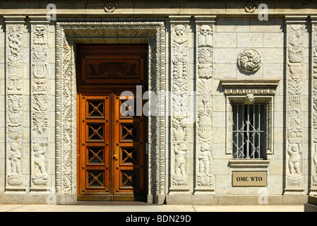 Door with bas-relief decoration at the main entrance to the Centre William Rappard, headquarters of the World Trade - Stock Photo