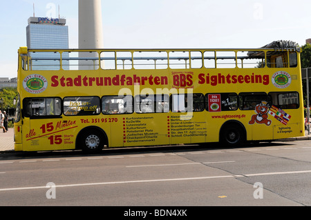 Sightseeing bus driving near the Fernsehturm TV tower, capital Berlin, Germany, Europe - Stock Photo