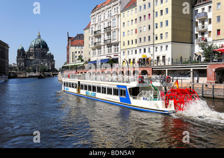 Passenger boat on the Spree river, in the back the Berliner Dom cathedral, capital Berlin, Germany, Europe - Stock Photo