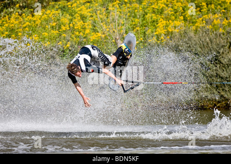 Young man doing waterski tricks at the EAME 2009 championships, Vallensbaek, Denmark, Europe - Stock Photo