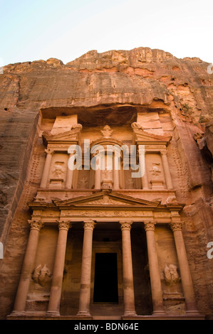 'The Treasury,' an ancient tomb carved from sandstone cliffs at Petra. - Stock Photo