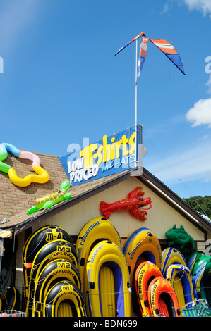 Exterior facade of beach toy store in Eastham, Cape Cod with inflatable rafts on display, USA - Stock Photo